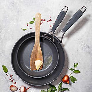 Ceramic nonstick hard-anodized aluminum 2-piece fry pan set.