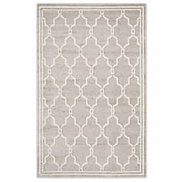 Safavieh Amherst 8-Foot x 10-Foot Quake Indoor/Outdoor Area Rug in Navy/Beige