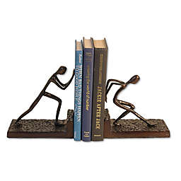 Danya B. Men Pushing Metal Bookends in Brown