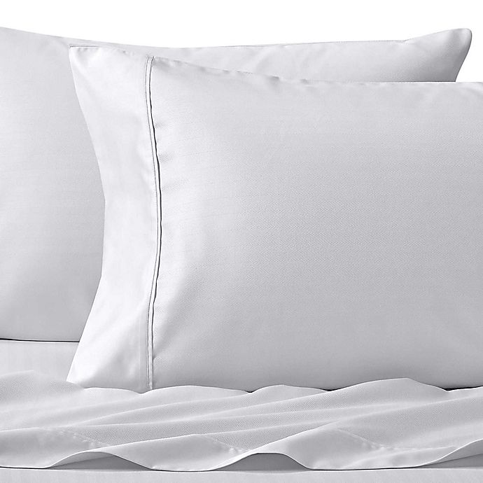 Alternate image 1 for Wamsutta® Dream Zone® PimaCott Herringbone 625-Thread-Count Standard Pillowcase Set in White