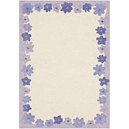 Safavieh Kids® Floral Border Area Rug in Ivory/Blue
