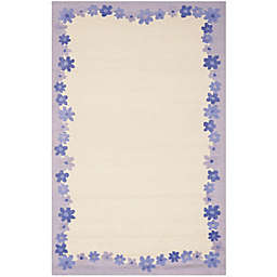 Safavieh Kids® Floral Border 5-Foot x 8-Foot Area Rug in Ivory/Blue