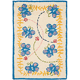Safavieh Kids® Butterfly 6-Foot x 9-Foot Area Rug in Ivory/Blue