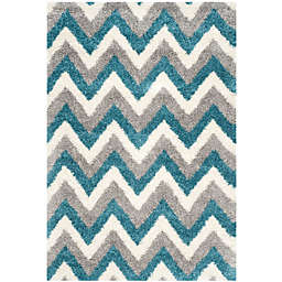 Safavieh Kids® Zigzag 5-Foot 3-Inch x 7-Foot 6-Inch Shag Area Rug in Ivory/Blue