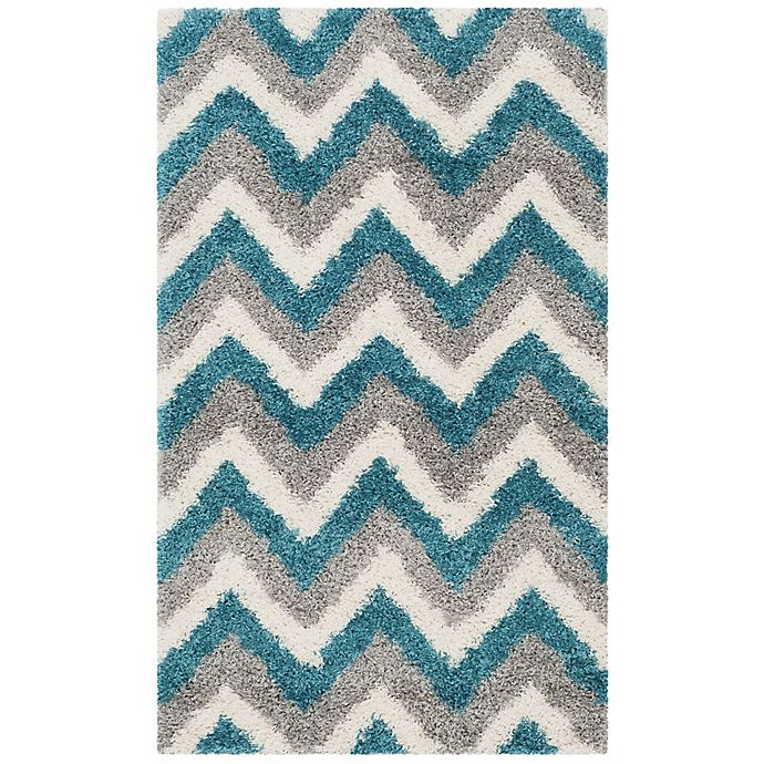 Alternate image 1 for Safavieh Kids® Zigzag 2-Foot 3-Inch x 5-Foot Shag Area Rug in Ivory/Blue