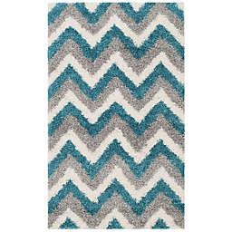 Safavieh Kids® Zigzag 2-Foot 3-Inch x 5-Foot Shag Area Rug in Ivory/Blue
