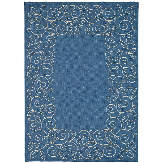 Alternate image 1 for Safavieh Vine Scroll 6-Foot 7-Inch x 9-Foot 6-Inch Indoor/Outdoor Area Rug in Blue