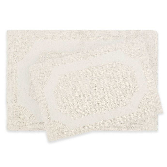 Alternate image 1 for Laura Ashley Reversible Bath Rugs in Ivory (Set of 2)