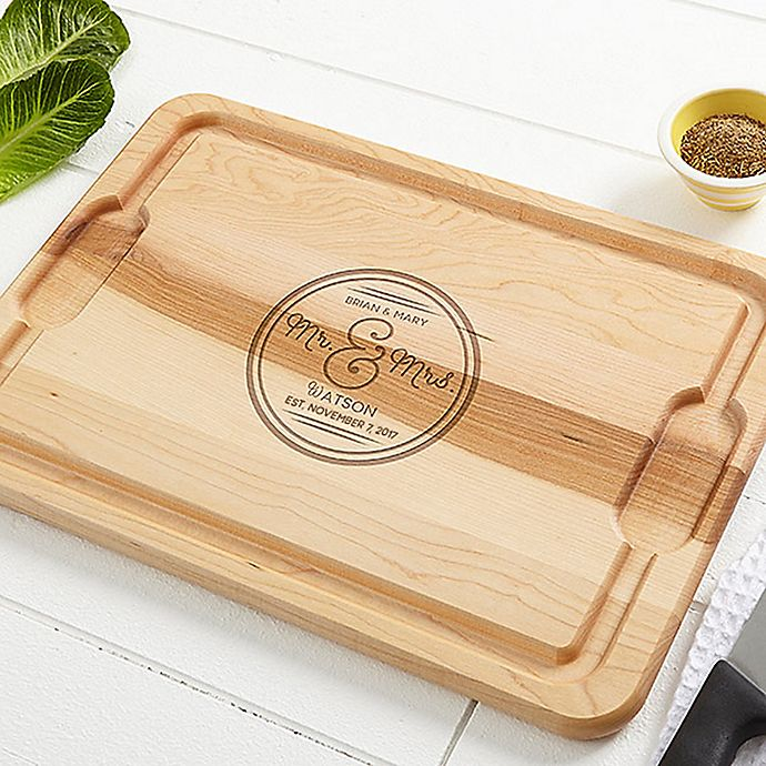 Alternate image 1 for Circle of Love Cutting Board in Maple