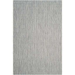 Safavieh Courtyard Chevron 4-Foot x 5-Foot 7-Inch Indoor/Outdoor Area Rug in Grey/Navy