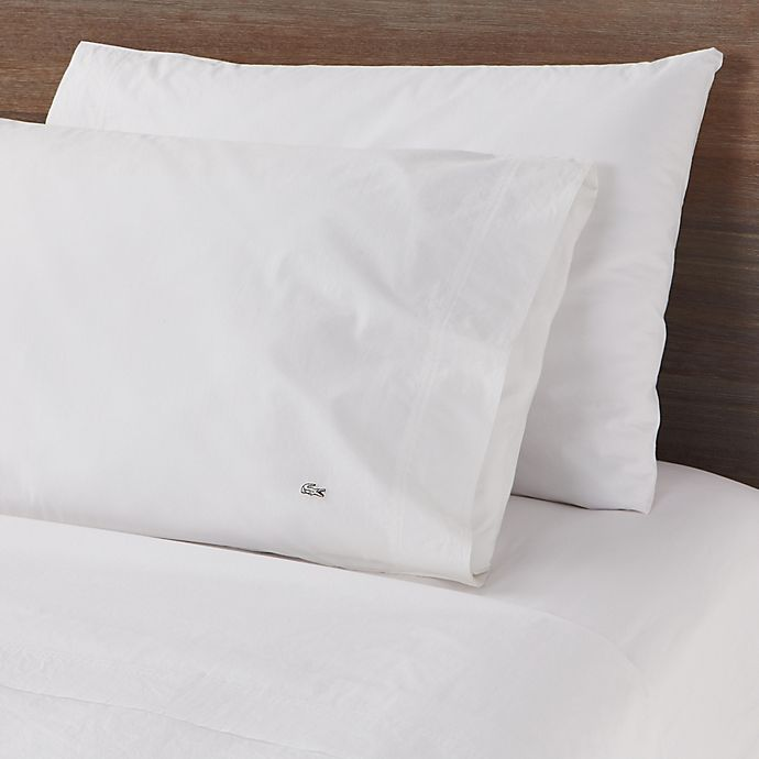 Alternate image 1 for Lacoste Solid Washed Cotton Percale 300-Thread-Count King Sheet Set in White