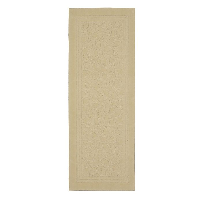 Alternate image 1 for Mohawk Home Wellington 2-Foot x 5-Foot Bath Rug in Ivory