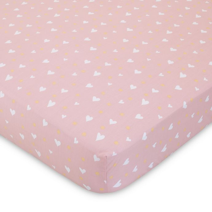 Alternate image 1 for ED Ellen DeGeneres Cotton Tail Heart-Print Fitted Crib Sheet in Pink/Peach