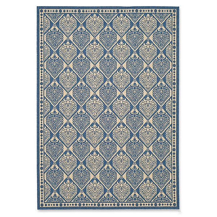 Alternate image 1 for Safavieh Courtyard 5-Foot 3-Inch x 7-Foot 7-Inch Phoebe Indoor/Outdoor Rug in Blue/Ivory