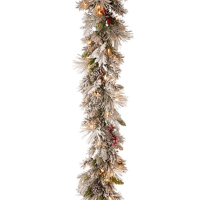 Alternate image 1 for National Tree Company® Pre-Lit LED 9-Foot Snowy Bedford Pine Garland