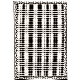 Nikki Chu by Jaipur Living Decora Melon Indoor/Outdoor Rug in Grey/Black