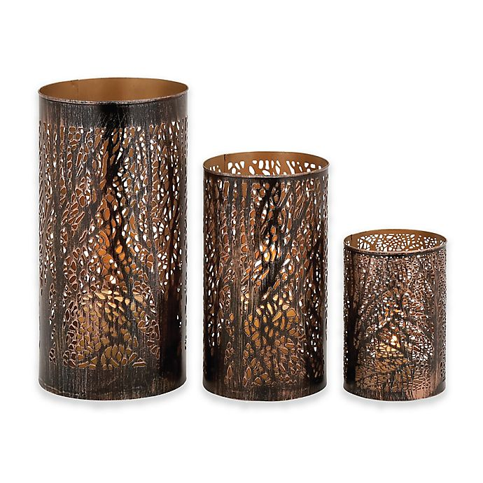 Alternate image 1 for Ridge Road Décor Pierced Forest 3-Piece Iron Hurricane Candle Holder Set in Bronze