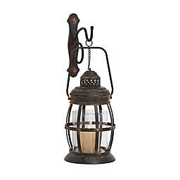 Ridge Road Décor Oval Lantern Iron/Glass Candle Sconce in Bronze