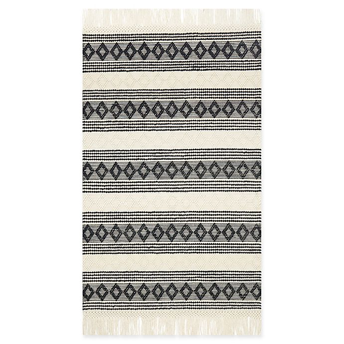 Shop Magnolia Home by Joanna Gaines Holloway Rug in Ivory/Black from Bed Bath & Beyond on Openhaus