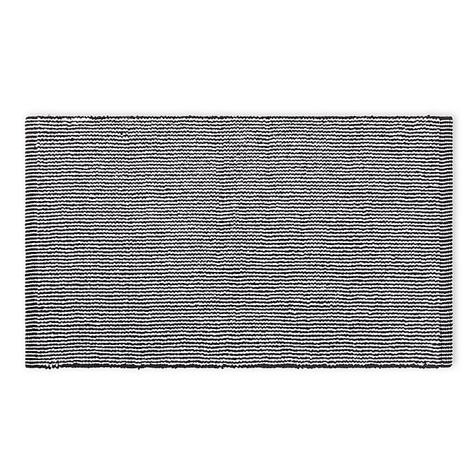 Alternate image 1 for Calvin Klein Donald 34-Inch x 21-Inch Bath Mat in White/Black