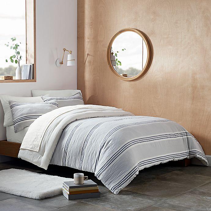 Alternate image 1 for UGG® Devon Stripe 3-Piece Reversible Full/Queen Comforter Set in Navy Stripe