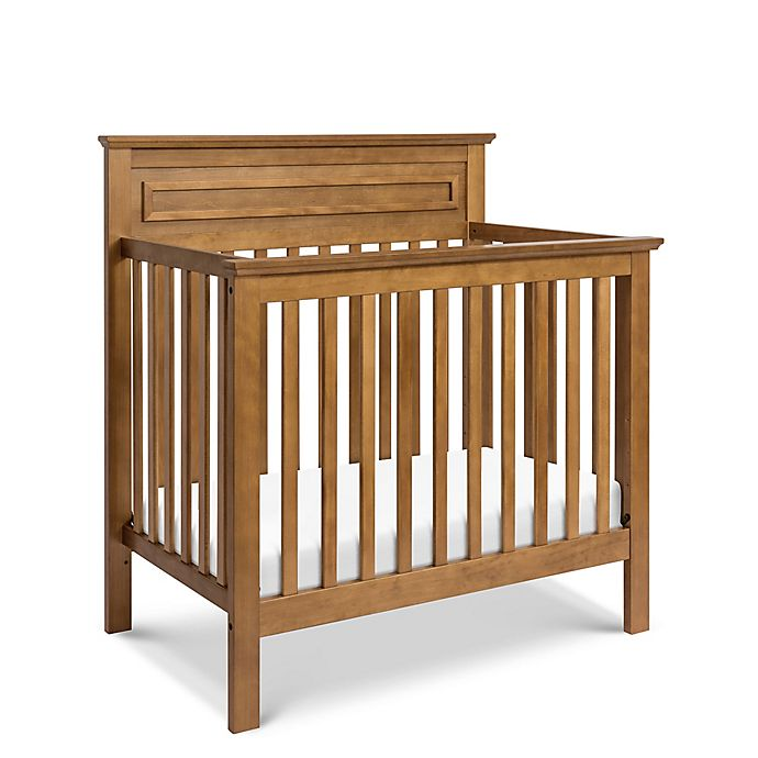 Alternate image 1 for DaVinci Autumn 4-in-1 Convertible Mini Crib in Chestnut
