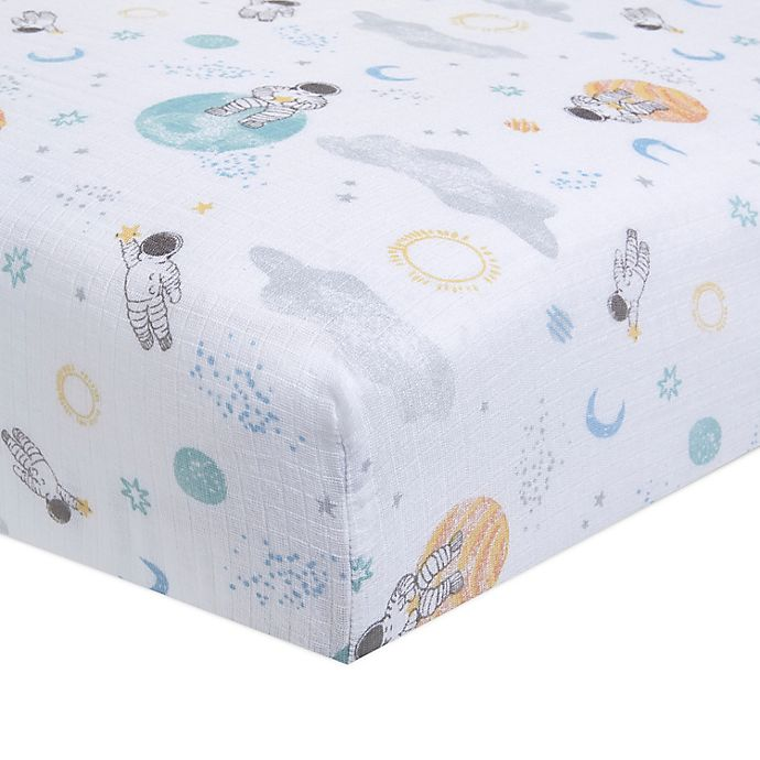 Alternate image 1 for aden + anais™ essentials Space Muslin Fitted Crib Sheet in Blue