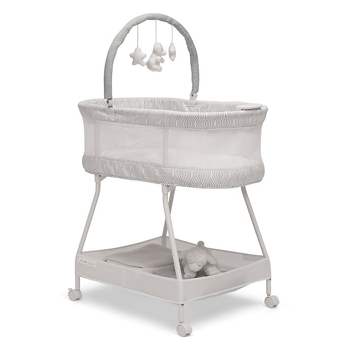 Alternate image 1 for Delta Children Wave Vibrating Bassinet in White/Grey with Toy Bar