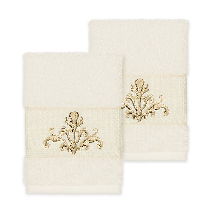 Alternate image 1 for Linum Home Textiles Scarlet Crest Washcloths in Cream (Set of 2)