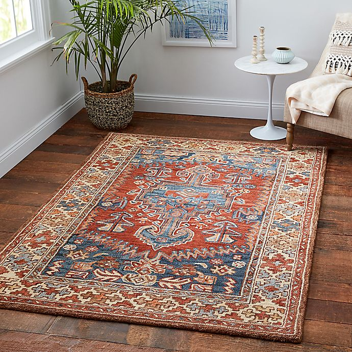Sienna Wool Area Rug In Rust Blue Bed