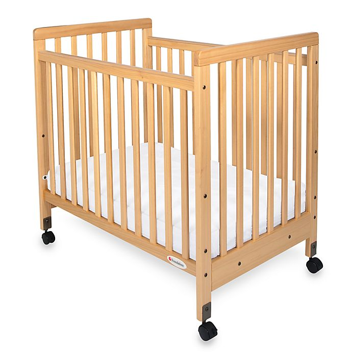 Alternate image 1 for Foundations® SafetyCraft® Compact Fixed-Side Slatted Crib in Natural