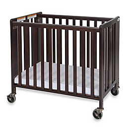 Foundations® HideAway™ Easy Roll Compact Fixed-Side Folding Crib in Cherry