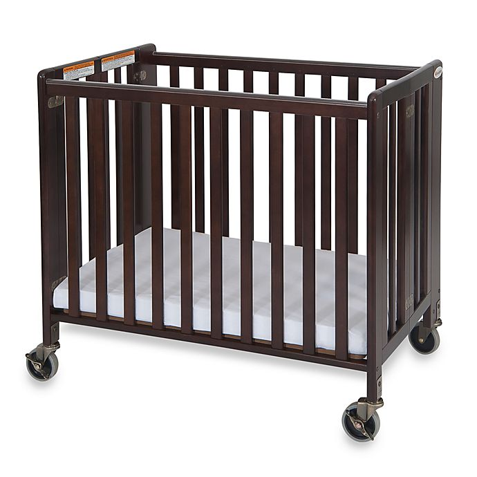 Alternate image 1 for Foundations® HideAway™ Easy Roll Compact Fixed-Side Folding Crib in Cherry