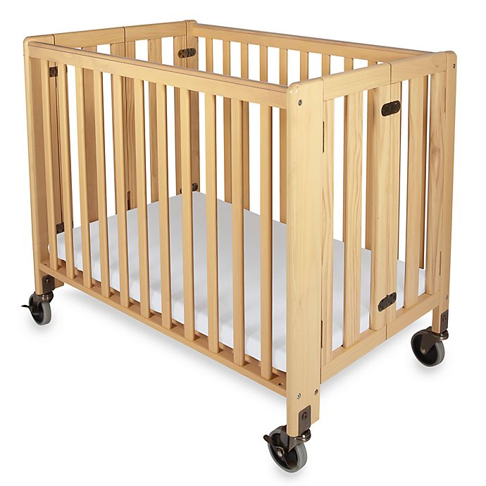 Alternate image 1 for Foundations® HideAway Easy Roll Compact Fixed-Side Folding Crib in Natural