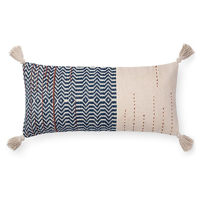 Alternate image 1 for Magnolia Home by Joanna Gaines Amie 27-Inch x 12-Inch Oblong Throw Pillow in Ivory/Indigo
