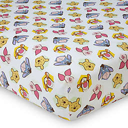 Disney® Peeking Pooh Fitted Crib Sheet in Yellow