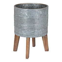 Kate and Laurel® Gavri Planter with Stand in Grey/Brown