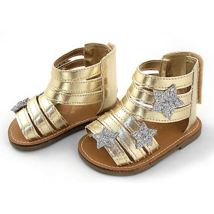 Alternate image 1 for Rising Star™ Metallic Star Sandal in Gold