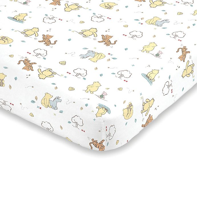 Alternate image 1 for Disney® Classic Pooh Fitted Crib Sheet in Ivory