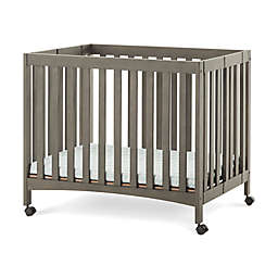 Child Craft™ Forever Eclectic London™ Mini Folding Crib in Dapper Grey