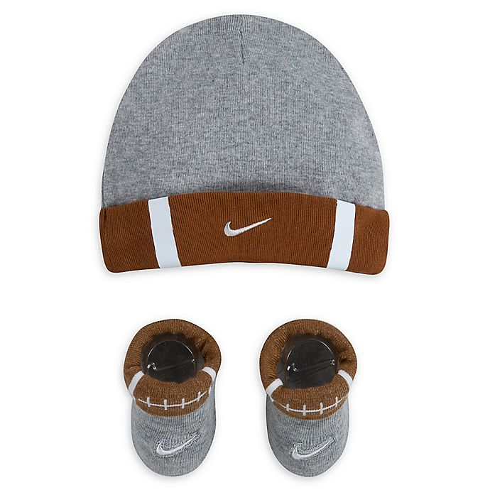 Alternate image 1 for Nike® Size 0-6M 2-Piece Futura Sports Ball Cap and Bootie Set in Light Tan