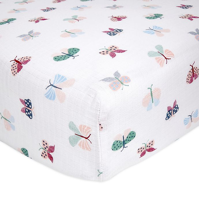 Alternate image 1 for aden + anais® essentials Floral Fauna Fitted Muslin Crib Sheet in Pink