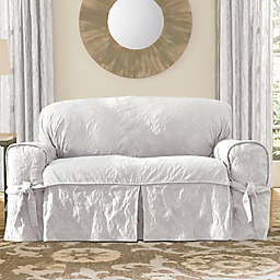 Sure Fit® Matelasse Damask One-Piece Loveseat Slipcover in White