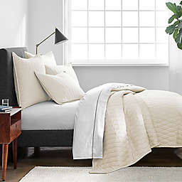 Under The Canopy® Ogee Satin Weave Twin Quilt in Ivory