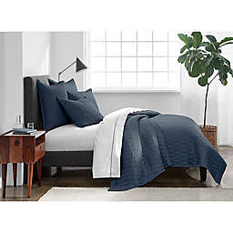 Under The Canopy® Ogee Satin Weave Twin Quilt in Indigo