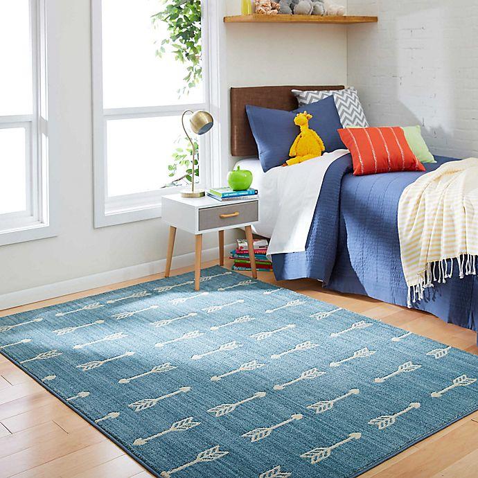 Alternate image 1 for Marmalade™ Finnick Arrow Stripe 5' x 7' Area Rug in Blue