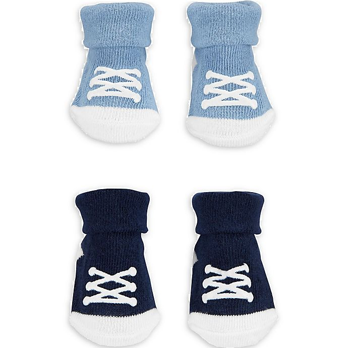 Alternate image 1 for carter's® Newborn 2-Pack Sneaker Keepsake Booties in Blue/Navy
