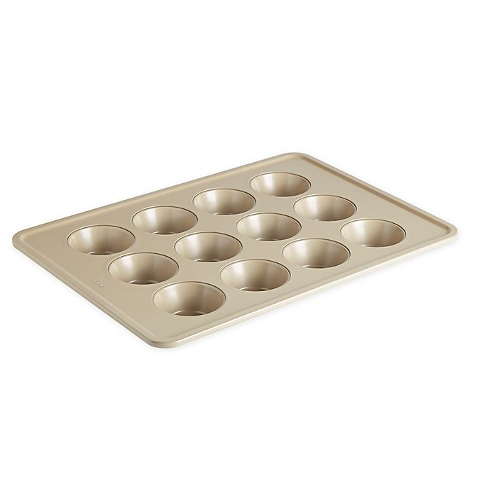 Alternate image 1 for Our Table™ 12-Cup Textured Muffin Pan in Beige