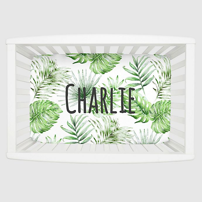 Alternate image 1 for Carousel Designs® Painted Tropical Mini Fitted Crib Sheet in Green/White