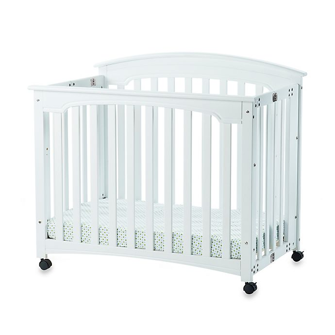 Alternate image 1 for Child Craft™ Wadsworth Folding Mini Crib in Matte White